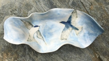 Stoneware bowl, sgraffito carved design of swallows in flight